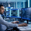One of the most exciting careers in security. A cyber security professional sits in front of a computer.